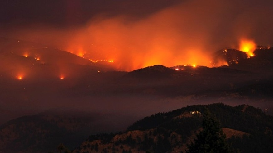 Sept. 7: A wildfire burns outside of Boulder, Colo. Authorities said Tuesday night they counted 92 structures that have been destroyed and another eight that have been damaged.