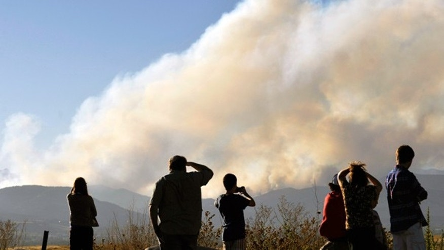 Sept. 6: Spectators watch as a fire burns in 4-Mile Canyon near Boulder, Colo.