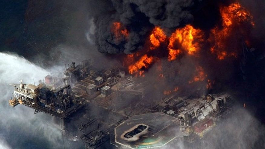 In this April 21, 2010 file aerial photo taken in the Gulf of Mexico more than 50 miles southeast of Venice, La., the Deepwater Horizon oil rig is seen burning.