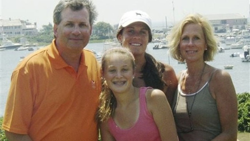This June 2007 photo provided by Dr. William Petit Jr., shows Dr. Petit, left, with his daughters Michaela, front, Hayley, center rear, and his wife, Jennifer Hawke-Petit, on Cape Cod, Mass. Dr. Petit was severely beaten and his wife and two daughters were killed during a home invasion in Cheshire, Conn., July 23, 2007.  (AP)