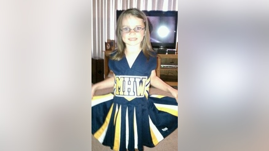 Jennifer and Duane Tesch, of Madison Heights, say their daughter, Kennedy, seen here, was unanimously voted off of the Madison Heights Wolverines flag football cheerleading team during a team meeting Tuesday night.