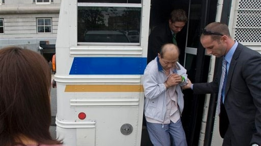 A suspect is helped off an Essex County Sheriff's bus at the Federal Court House, Thursday Sept. 16, 2010 in Newark, NJ.  Federal prosecutors in New Jersey say 53 people are charged in a widespread identity theft and fraud investigation.