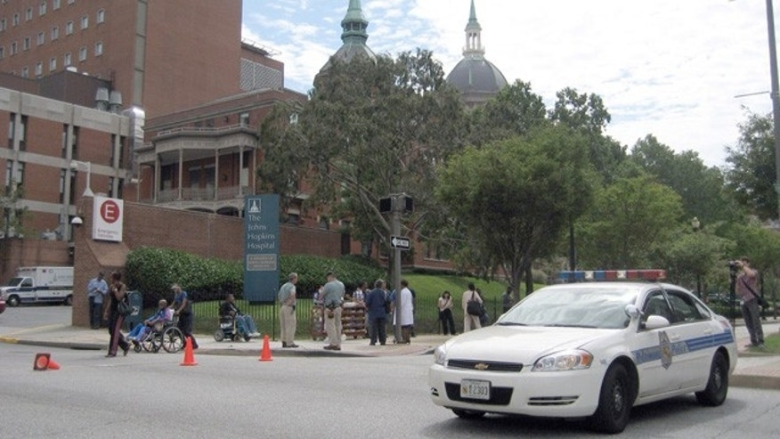 Sept. 16: A police vehicle arrives at Johns Hopkins Hospital in Baltimore after a shooting.
