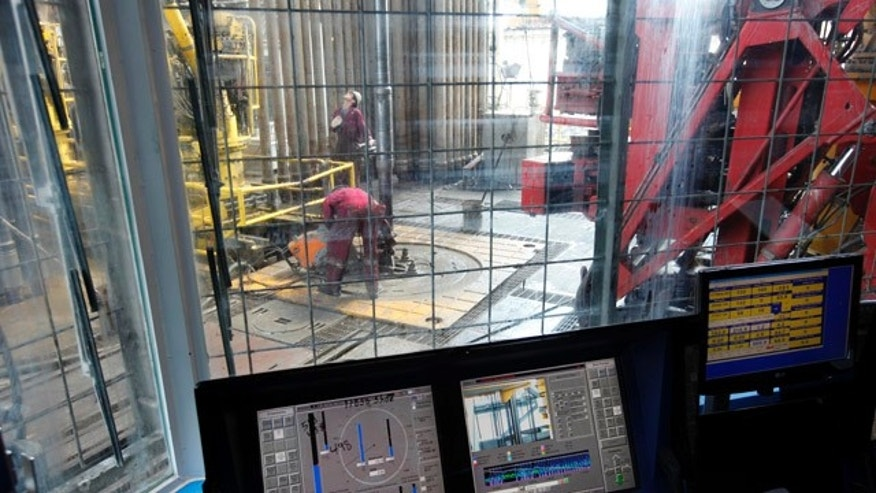 Sept. 18: Workers on the drilling floor are seen on from the window of the drilling cage as the drilling pipe is removed on the Development Driller III which drilled the relief well and pumped cement to seal the Macondo well.