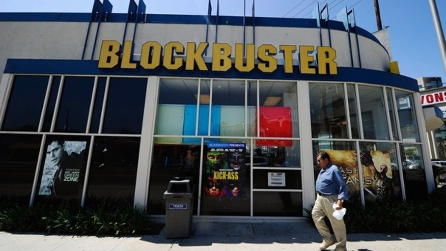 Aug. 27: People walk past a Blockbuster store in Los Angeles, California