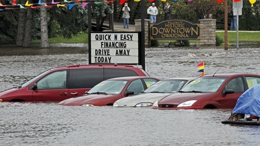 Sept. 24: Floodwaters partially submerge vehicles in a used car lot in Owatonna, Minn.