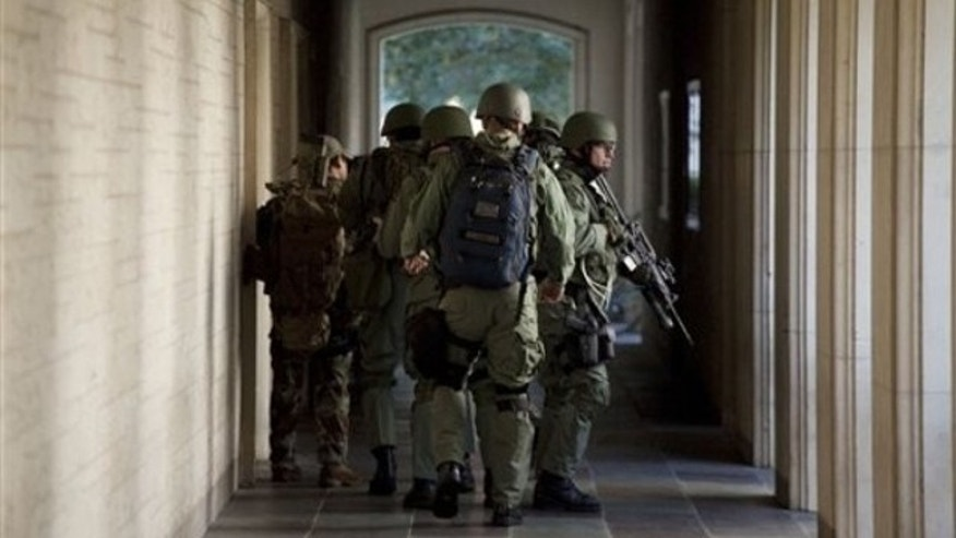 Sept. 28: Soldiers prepare to enter Calhoun Hall at the University of Texas in Austin, Texas. A gunman opened fire Tuesday inside the Perry-Castaneda Library then fatally shot himself, and police are searching for a possible second suspect, university police said (AP).