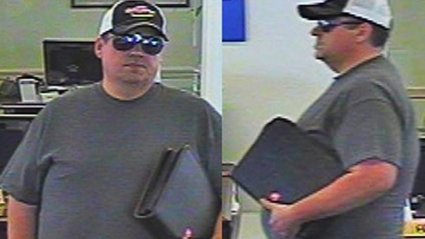 This undated file photo from security video released by the FBI, shows a man dubbed as the 'burly bandit' inside a bank in Somers, Conn.