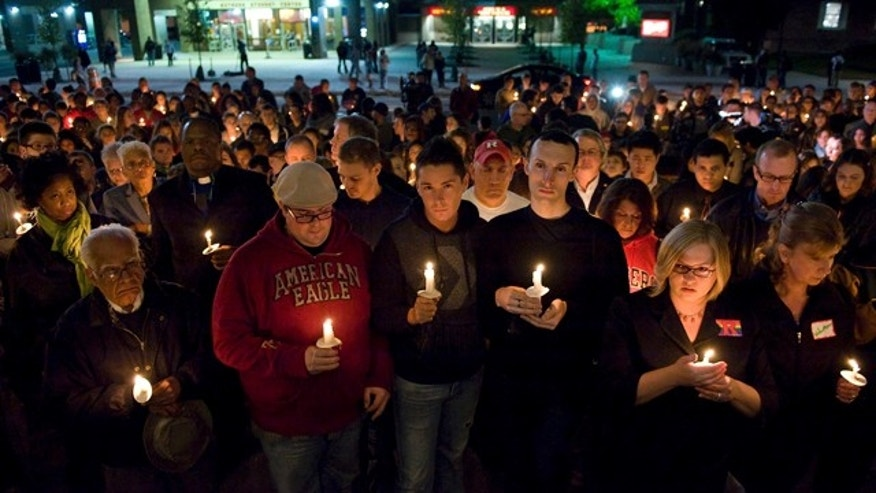 Oct. 3: People participate in a candlelight vigil for Rutgers University freshman Tyler Clementi at Brower Commons on the Rutgers campus in New Brunswick, N.J.