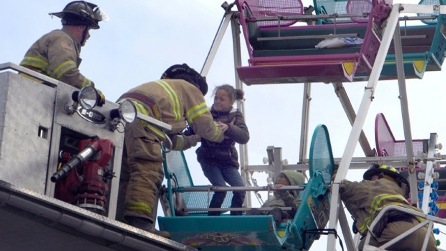 Oct. 2: Firefighters rescue riders from a Ferris wheel which became stuck in downtown Racine,Wis., during a street festival.