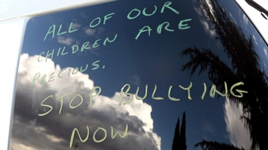 This Oct. 1, 2010 photo shows a message written on a vehicle window at Seth Walsh's memorial service at the First Baptist Church in Tehachapi, Calif. The gay teen, who police determined was bullied for at least the past two years, was found Sept. 19, 2010 by his family, unconscious after he hanged himself from a tree in their backyard, according to police reports. He died the next day. A spate of teen suicides linked to anti-gay harassment is prompting school officials nationwide to rethink their efforts against bullying _ and in the process, risk entanglement in a bitter ideological debate. The conflict: Gay-rights supporters insist that any effective anti-bullying program must include specific components addressing harassment of gay youth. But religious conservatives condemn that approach as an unnecessary and manipulative tactic to sway young people's views of homosexuality. (AP Photo/The Bakersfield Californian, Henry A. Barrios)