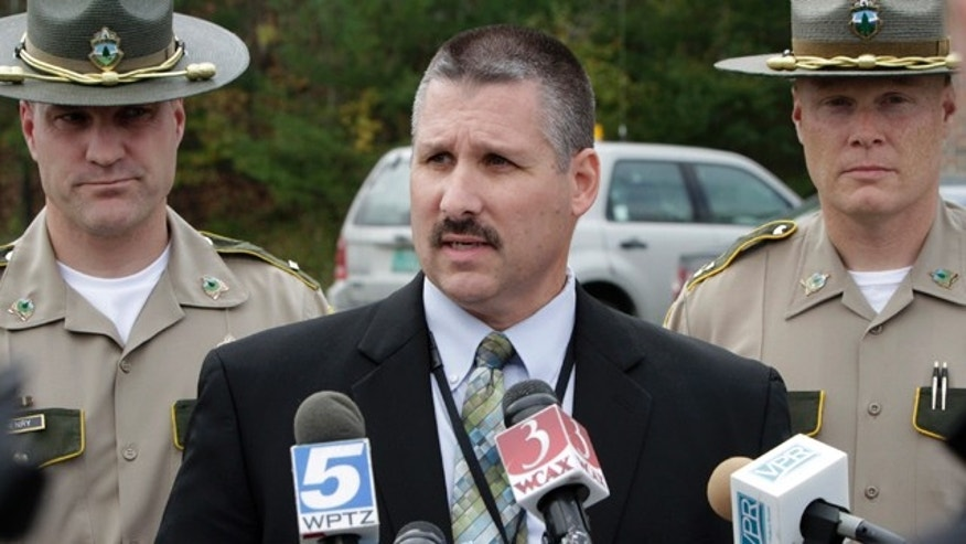 Oct. 4, 2010: Vermont State Police Maj. Ed Ledo, center, is seen at a news conference in St. Johnsbury, Vt.