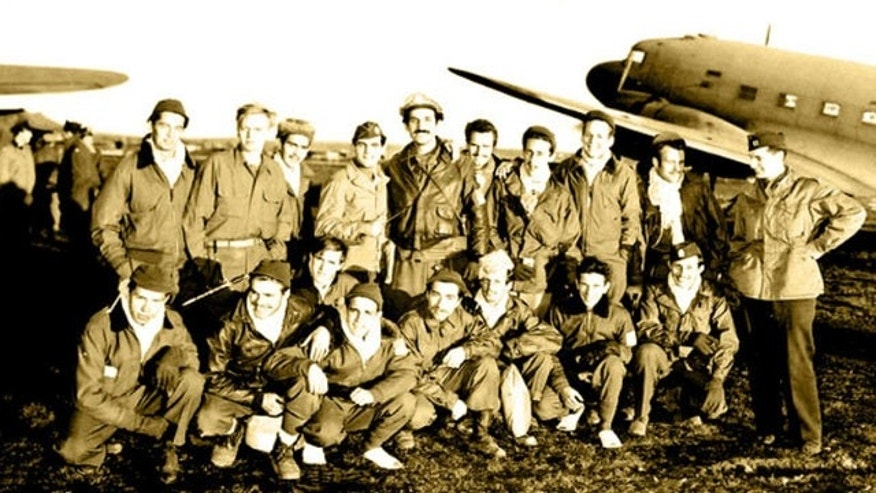 Dec. 28, 1944: OSS Capt. George Vujnovich, right, stands in Bari, Italy, with a group of Allied airmen he helped rescue after they were downed over Nazi occupied Serbia. This was the largest air rescue of Americans behind enemy lines in any war.