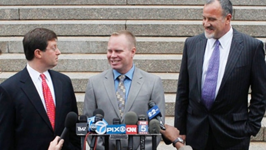 Oct. 19: Steven Slater, center, speaks to the media after leaving a Queens courthouse in New York. The former JetBlue flight attendant has pleaded guilty to attempted criminal mischief after an Aug. 9 incident when he got on the loudspeaker, cursed at passengers, then slid down the plane's emergency chute with a beer.