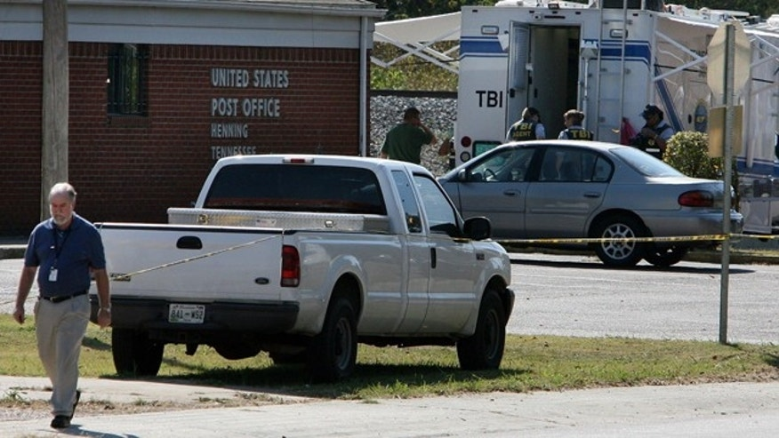 Oct. 18: Investigators are on the scene of a double murder at the U.S. Post Office in Henning, Tenn.