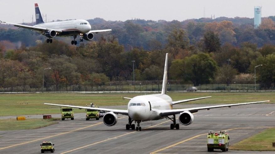 Oct. 29: A United Parcel Service jet is seen isolated on a runway at Philadelphia International Airport. Law enforcement officials are investigating reports of suspicious packages on cargo planes in Philadelphia and Newark, N.J.