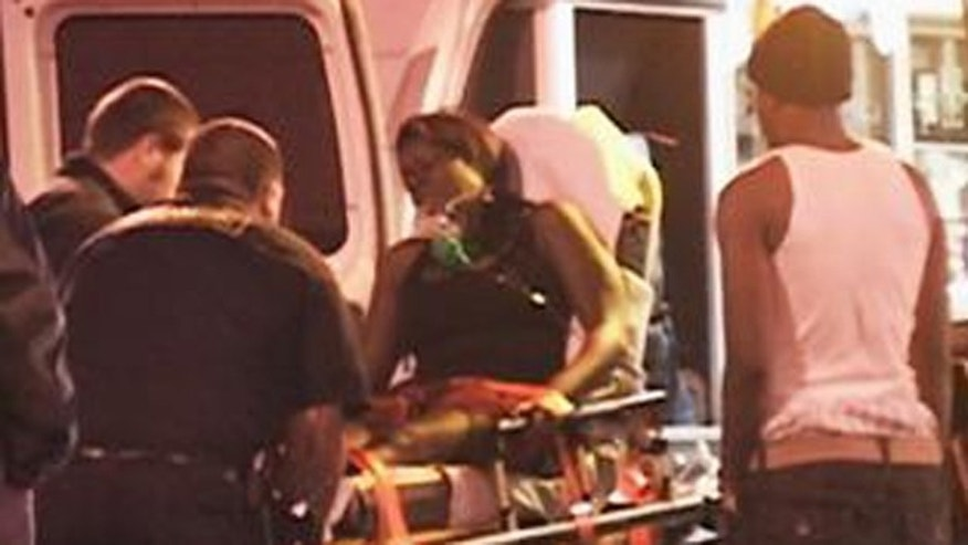 Oct. 30: A victim of a shooting at an Oakland Halloween party gets loaded into an ambulance.
