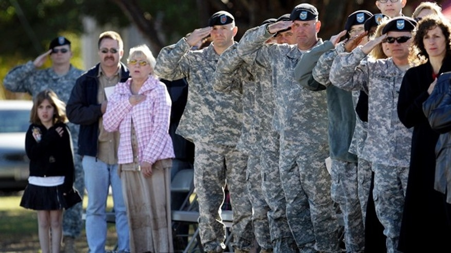 Nov. 5: People stand for the national anthem during an awards ceremony and memorial stone unveiling commemorating the one-year anniversary of the worst mass shooting on a U.S. military base, where 13 people were killed and dozens wounded in Fort Hood, Texas. (AP)