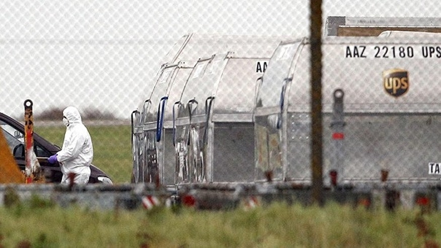 Oct. 29: Activity around UPS containers in the cargo area of East Midlands Airport, near Nottingham central England after suspicious packages containing explosives on a cargo flight at a British airport sparked a security alert in at least two United States cities.