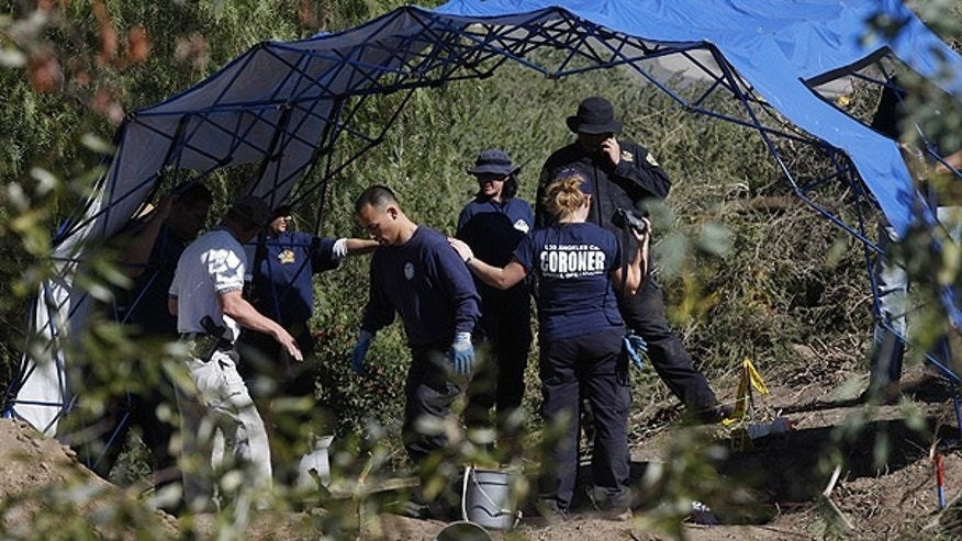 Nov. 4: Investigators with the Los Angeles County Coroner carry out a forensic dig in a canyon in the Santa Clarita Valley, Calif.