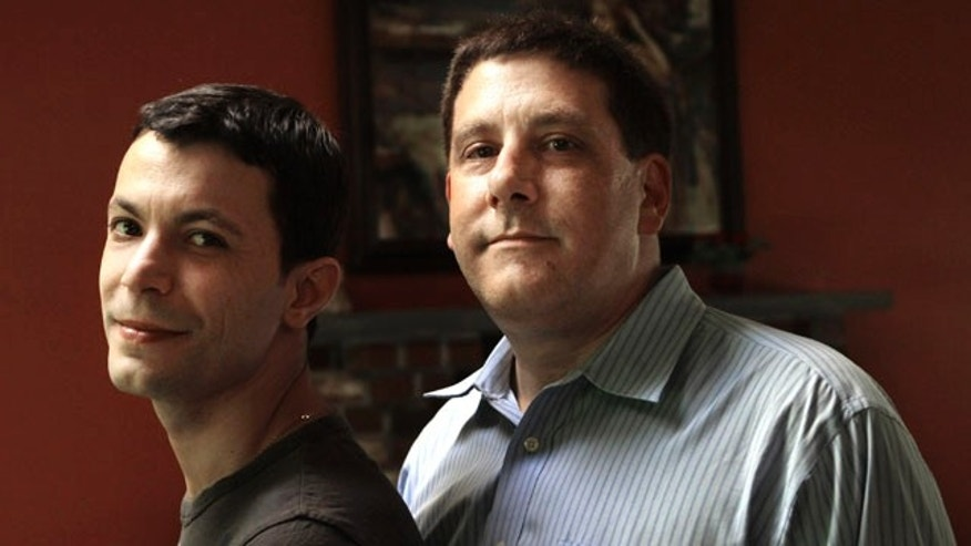 June 4: Brazilian-born Genesio Oliveira, 31, left, and his husband Tim Coco, 49, of Haverhill, Mass., stand together at their home in Haverhill. The two were married in 2005 but separated after Oliveira was denied asylum in the U.S. Oliveira could face deportation because U.S. Attorney General Eric Holder has not reversed the immigration ruling initially separating the couple.