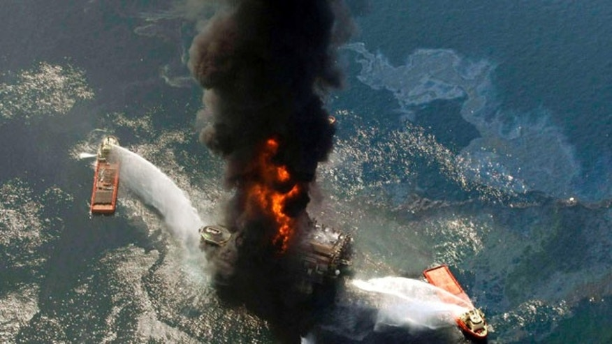 April 21: This file photo shows BP's Deepwater Horizon oil rig burning after an explosion in the Gulf of Mexico, off the southeast tip of Louisiana. Scientists recently discovered certain elements from the remains of the spill moved exceptionally quickly through the area's ecosystem.