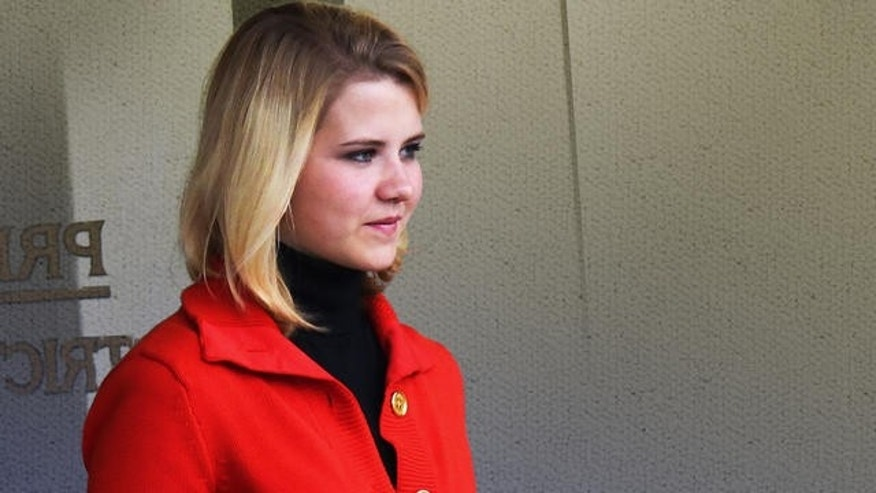 Nov. 8, 2010: Elizabeth Smart leaves the Frank E. Moss Federal Courthouse in Salt Lake City after testifying in the trial of Brian David Mitchell, the man accused of kidnapping her in June 2002 (AP).