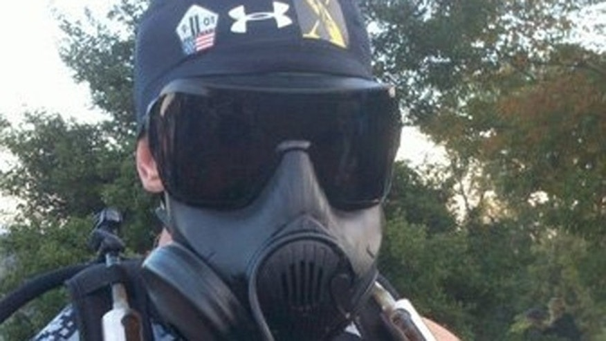 Oct. 31: Soles stands with his gas mask at the Marine Corps Marathon in Washington, D.C. (FoxNews.com).