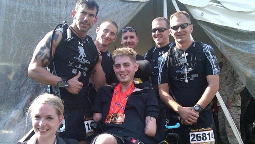 Oct. 31: Peck surrounded by members of Team X-T.R.E.M.E. at the Marine Corps Marathon in Washington, D.C. (FoxNews.com).