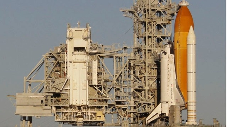 Nov. 5: Space shuttle Discovery is seen on pad 39a after a hydrogen gas leak caused NASA to halt the launch at the Kennedy Space Center in Cape Canaveral, Fla. Three more cracks have since been found, pushing back the new launch window to between Nov. 30 and Dec. 6.