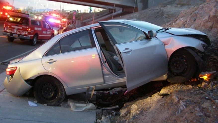 Nov. 5: In this photo released by the Utah Highway Patrol, a Toyota Camry is shown after it crashed exiting Interstate 80 in Wendover, Utah. Police say they suspect problems with the Camry's accelerator or floor mat, even though they report the owner completed a mandatory recall and repair.