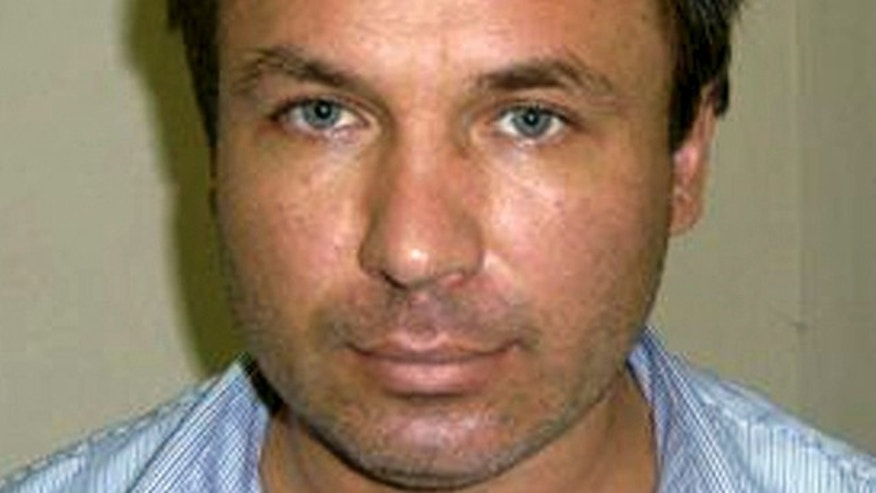 This photo provided by the U.S. Attorney's Office shows Russian pilot Konstantin Yaroshenko at the Republic of Liberia National Security Agency (RLNSA) headquarters on May 30, 2010, in Monrovia, Liberia. He was arrested on charges of conspiring to fly cocaine from South America to Africa (AP Photo/U.S. Attorney's Office).