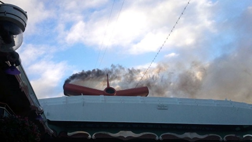 Nov. 8: Smoke billows from the engine compartment of the crippled cruise ship Carnival Splendor off the coast of Mexico. An engine fire aboard the 952-foot cruise liner that morning knocked out power early in its seven-day trip to the Mexican Riviera, setting the ship adrift about 200 miles outside San Diego and 44 miles off the coast of Mexico.