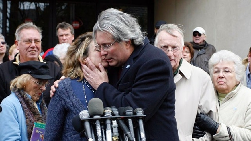Nov. 8: Hanna Chapman, left, hugs her brother Dr. William Petit Jr. following the sentence given to Steven Hayes, not pictured, following jury deliberations at the New Haven, Conn., County Courthouse. Hayes' lawyers asked for a two-month delay in sentencing to investigate their client's constitutional right to a fair trial amid heavy publicity.