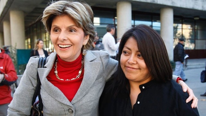 Nov. 17: Nicky Diaz Santillan, right, and her attorney Gloria Allred, left, smile as they leave a hearing in San Jose, Calif. Former California gubernatorial candidate Meg Whitman agreed to provide Diaz Santillan, her former housekeeper of nine years and an illegal immigrant, with $5,500 in unpaid wages in a settlement.