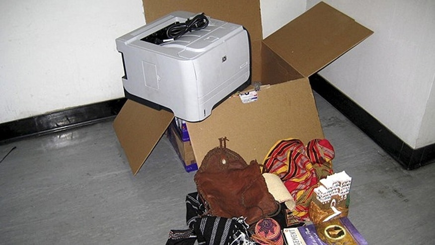 This undated photo released by the Dubai Police via the state Emirates News Agency (WAM) on Saturday, Oct. 30, 2010, claims to show a computer printer and other contents of a package found onboard a cargo plane coming from Yemen, in Dubai, United Arab Emirates.