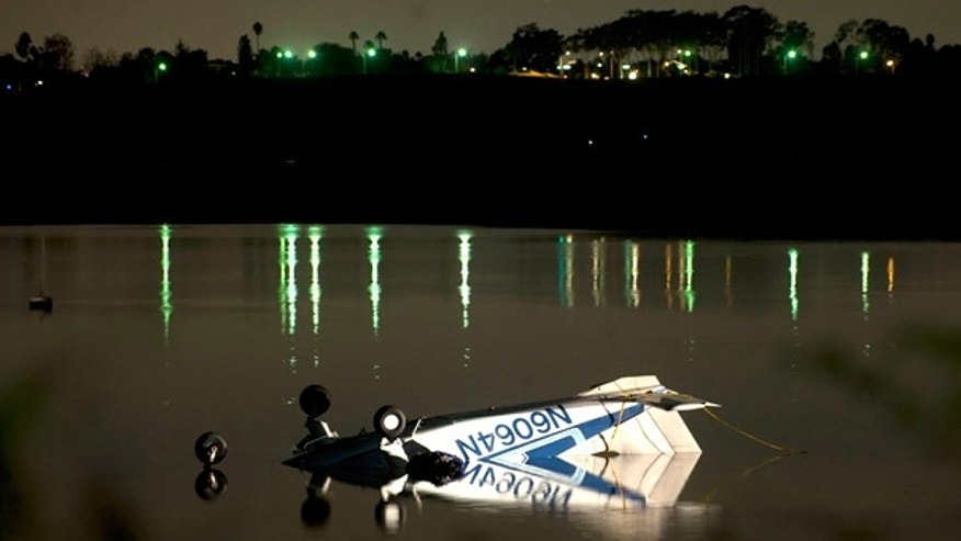 Nov. 21: Single engine plane rests in the shallow waters of Upper Newport Bay in Newport Beach, Calif.