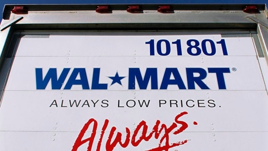 Oct. 19: The Wal-Mart logo is seen on a delivery truck in Springfield, Ill. Wal-Mart announced they plan to open stores well before dawn the day after Thanksgiving, known as Black Friday. Shopping in November is up from last year, and many retailers are engaging in early discounting campaigns in an effort to keep profits on the rise.
