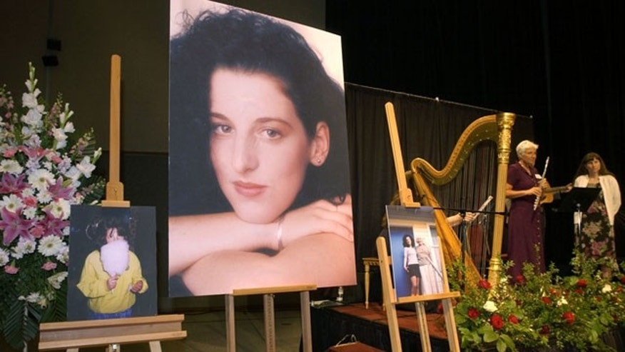 May 28, 2002: Photos of Chandra Levy are on display as musicians, right, stand by at the memorial service for Levy at the Modesto Centre Plaza in Modesto, Calif. A jury has now found Ingmar Guandique guilty of murdering the Washington intern in 2001, when her disappearance became a national sensation.