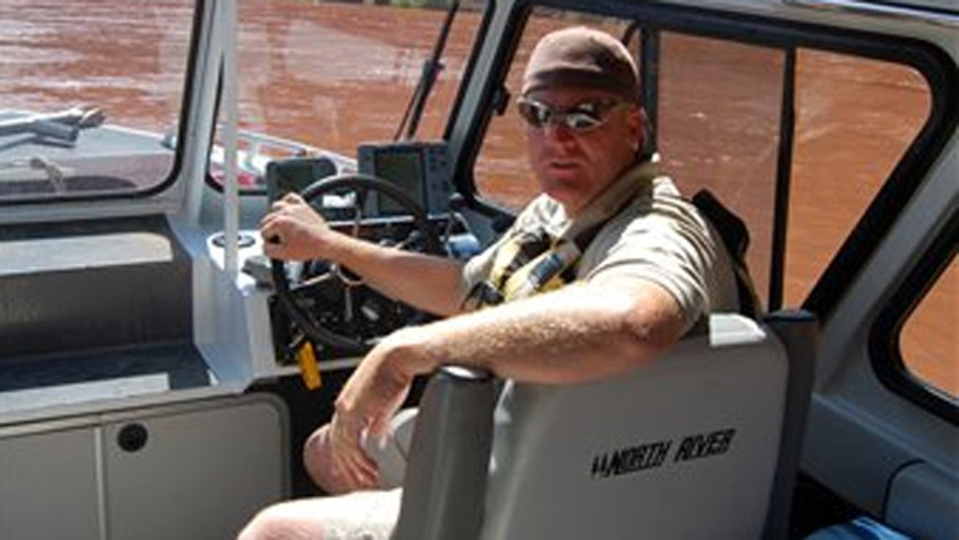 This undated photo provided by Utah State Parks and Recreation, shows Utah State Ranger Brody Young. Nearly 100 officers tracking a gunman in a rugged Utah canyon Saturday, Nov. 20, 2010, were believed to be closing in on the suspect accused of shooting and critically wounding Young.