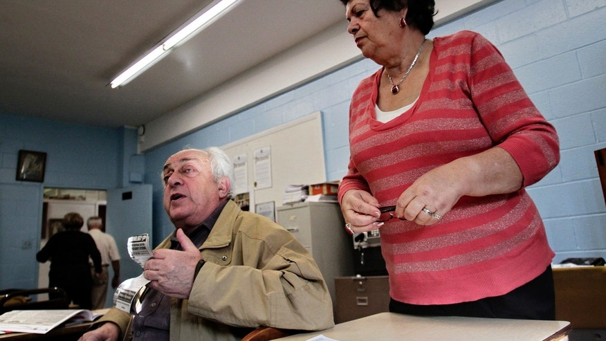 Nov. 17: Joseph Tokar, 75, left, and Klara Rakhlin, 72, both Holocaust survivors from the former Soviet Union, attend a weekly meeting of survivors in the Brooklyn borough of New York.