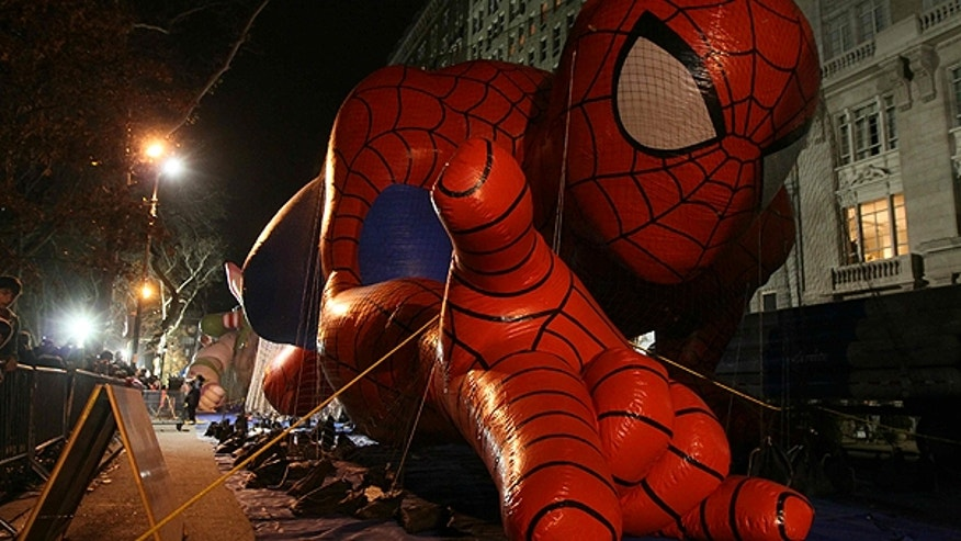 Nov. 14: The Spiderman balloon lies on the ground inflated as it, and other balloons, are readied for the Macy's Thanksgiving Day Parade in New York.