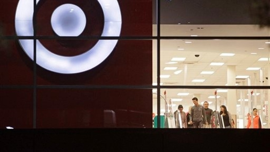 Nov. 16: Shoppers are seen leaving a Target store, in Atlanta. As retailers prepare for the crowds of shoppers on Black Friday with sharply reduced prices on everything from TVs to toys, they're also hoping for something else they couldn't count on last year: consumers springing for that deluxe high-end flat-panel TV or that big playset.
