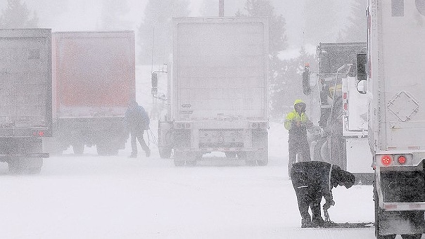 Nov. 24: Truckers pull over at a chain up station along Interstate 70 east of Copper Mountain, Colo.