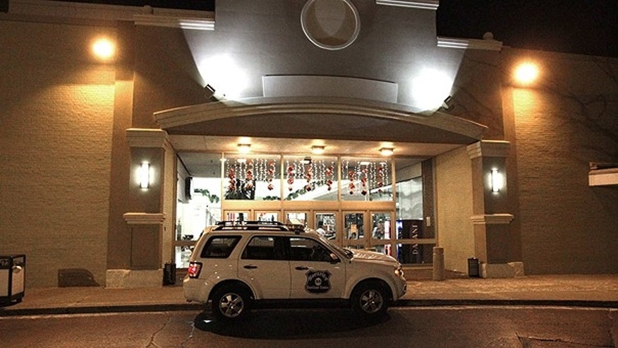 Nov. 27: A security vehicle sits parked outside the entrance to Eastland Mall in Harper Woods, Mich.