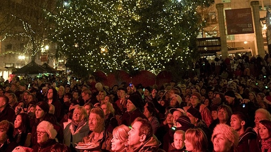Nov. 26: The tree is lit on Pioneer Courthouse square in Portland. A Somali-born teenager was arrested at 5:40 p.m. just after he dialed a cell phone that he thought would blow up a van laden with explosives in the ceremony.