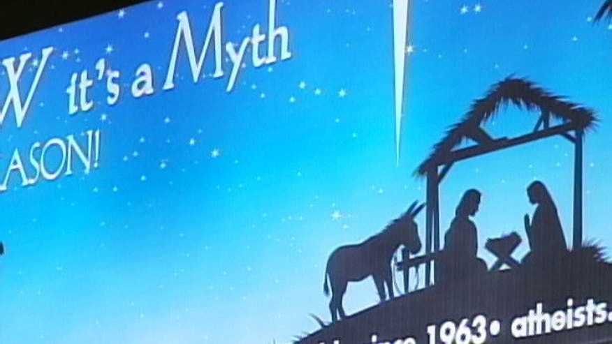 """The billboard, near the Lincoln Tunnel in North Bergen, N.J., depicts a silhouette of the Three Wise Men approaching a manger alongside the words: """"You KNOW it's a Myth. This Season, Celebrate REASON!""""  (MyFoxNY.com)"""