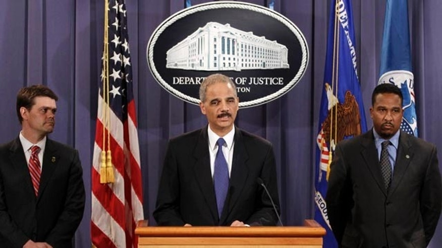 Nov. 29: Attorney General Eric Holder during a news conference at the Justice Department in Washington. Holder said federal agents acted properly in the case of a Somali-American man who allegedly tried to blow up what he thought was a van full of explosives in Portland, Ore., during the city's Christmas tree lighting ceremony.