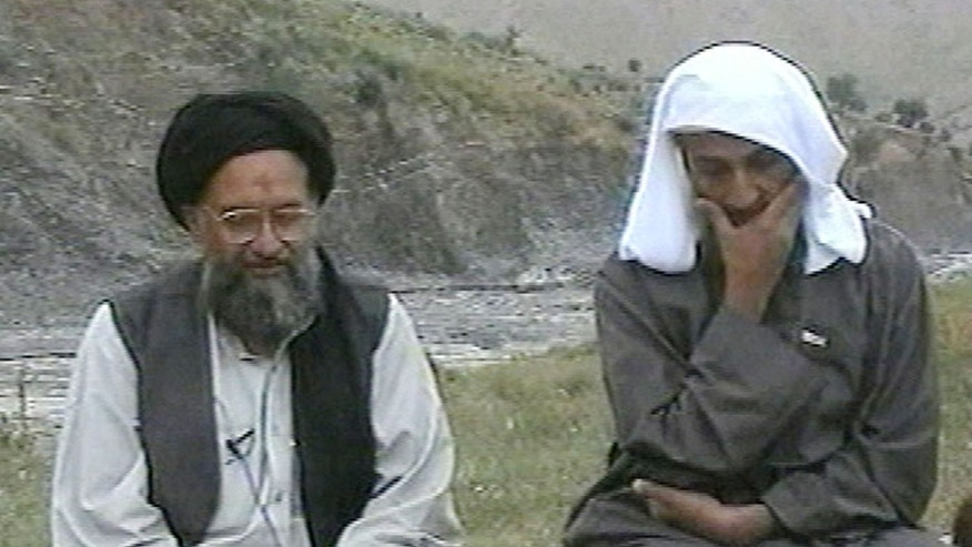 In this television image from Arab satellite station Al-Jazeera, Usama bin Laden, right, listens to his top deputy Ayman al-Zawahri speaking at an undisclosed location. The Associated Press says the CIA's pursuit of al-Zawahiri, a nine-year hunt at the root of last year's devastating suicide bombing at an agency base in Afghanistan, has come closer to capturing or killing the terrorist leader than previously known.