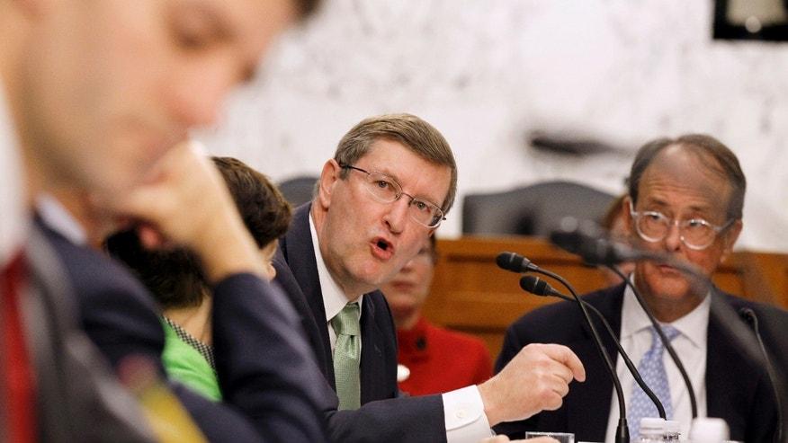 Dec. 1: Debt Commission member and Senate Budget Committee Chairman Sen. Kent Conrad, D-N.D., center, speaks during a meeting of the commission on Capitol Hill in Washington, D.C.
